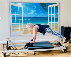 Plank on Pilates Reformer